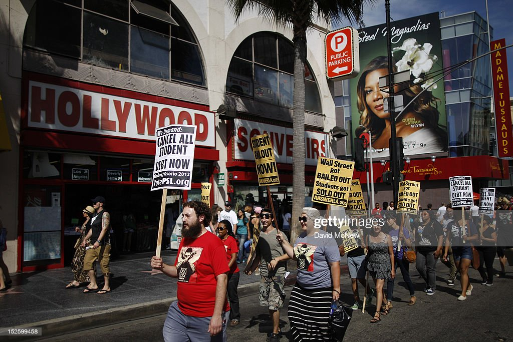 Students march on Hollywood Boulevard while protesting the rising costs of student loans for higher education on September 22, 2012 in the Hollywood section of Los Angeles, California. Citing bank bailouts, the protesters called for student debt cancelations.