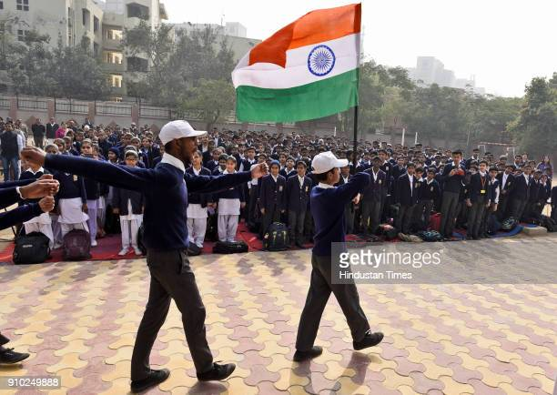 Students march past during the Republic Day celebrations at RPVV school in Civil Lines on January 25 2018 in New Delhi India