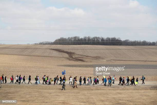 Students march the last leg of a 50mile journey into the hometown of House Speaker Paul Ryan to call attention to gun violence on March 28 2018 in...