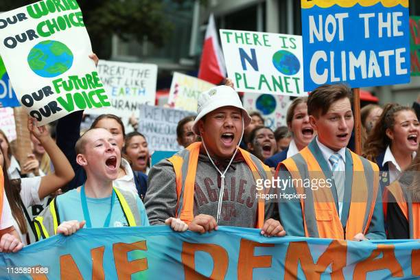 Students march through the streets during a strike to raise climate change awareness on March 15, 2019 in Wellington, New Zealand. The protests are...