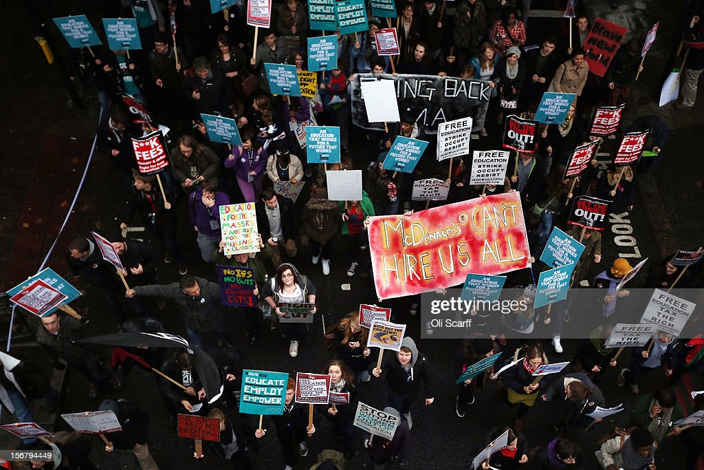 Students march through Westminster as they protest against the rising costs of further education on November 21, 2012 in London, England. The demonstration march was organised by the National Union of Students and is the first national student protest since a series of violent protests against tuition fees two years ago.