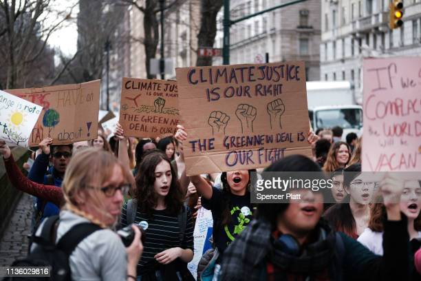 Students march to the Museum of Natural History to protest the lack of action on global warming and other climate related issues on March 15 2019 in...