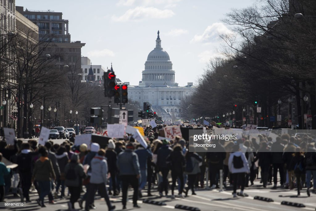 Students march towards the U.S. Capitol building during the