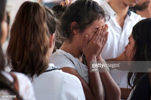 Students mourn during a mass for four highschool students tortured and killed with white weapons in Jojutla Morelos state Mexico on November 3 2016 /...