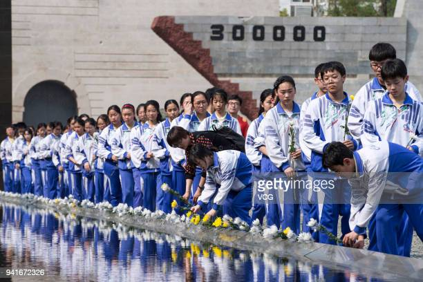 Students mourn the victims at Memorial Hall of the Victims in Nanjing Massacre by Japanese Invaders before Qingming Festival on April 3 2018 in...