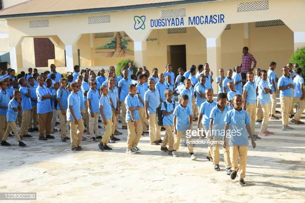 Students move to their classrooms while maintaining distance as schools begin in the Somalian capital Mogadishu on September 01 2020 under the...