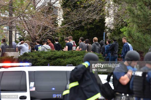 Students move towards a school bus to be evacuated from the scene of a shooting in which at least seven students were injured at the STEM School...