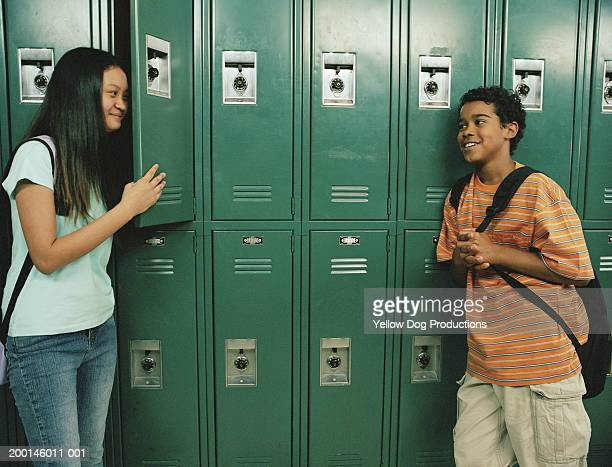 students (12-14) near lockers, smiling - open backpack stock pictures, royalty-free photos & images