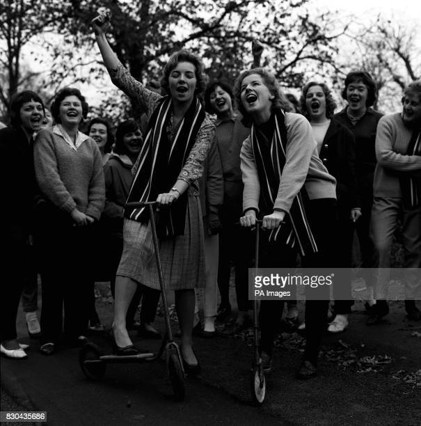 Students Netta Leslie and Jill Taylor outside St Georges Hall in Reading University singing college songs whilst training for the interUniversities...