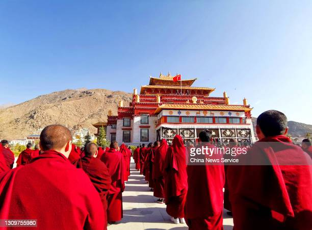 Students of a Buddhism college attend a flag-raising ceremony to mark the Serfs' Emancipation Day on March 28, 2021 in Lhasa, Tibet Autonomous Region...