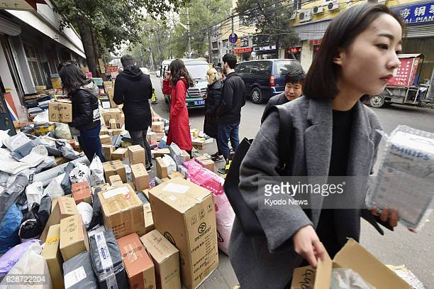 Students of a Chinese university in Beijing pick up products they ordered online and had delivered to the university in November 2016