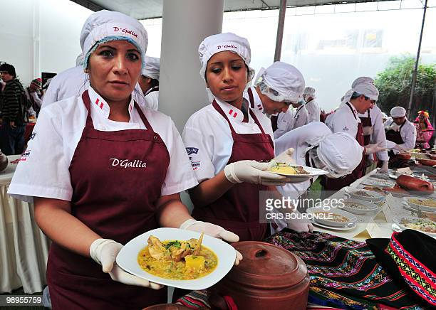 Students of a culinary school in Lima display a variety of over 100 regional soups on May 6 2010 The restaurant industry has been a boom in recent...