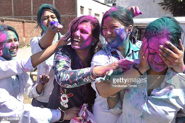 Students of a RKGIT Women College celebrate Holi festival on March 13 2014 in Ghaziabad India Holi is a festival of colors celebrated primarily in...