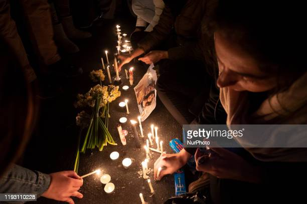 Students of a University light candles in memory of the victims of the Ukraine Boeing 737 passenger plane in Tehrans business district on January 11,...