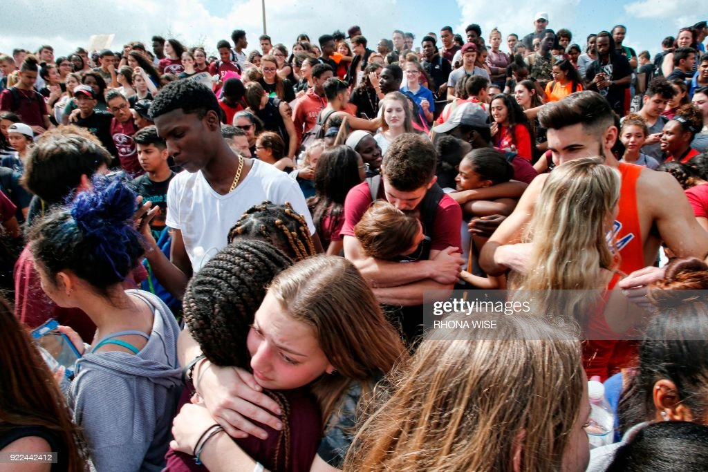 Students of area High Schools rally at Marjory Stoneman Douglas High School after participating in a county wide school walk out in Parkland, Florida on February 21, 2018. A former student, Nikolas Cruz, opened fire at Marjory Stoneman Douglas High School leaving 17 people dead and 15 injured on February 14. /