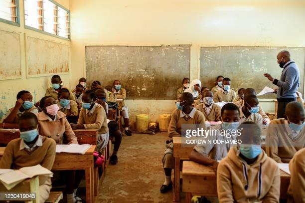 Students of Ayany Primary School attend the class in morning of the official re-opening day of public schools on January 4 in Kibera slum, Kenya, as...