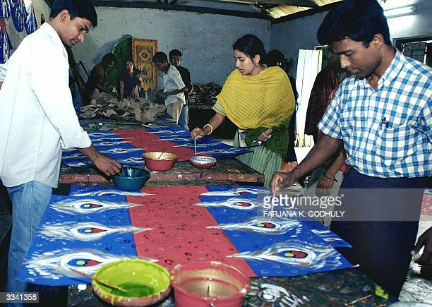 Students of Bangladesh's fine art university paint peacock tails on paper on the eve of Bengali New Year in Dhaka 12 April 2004 Across the country...