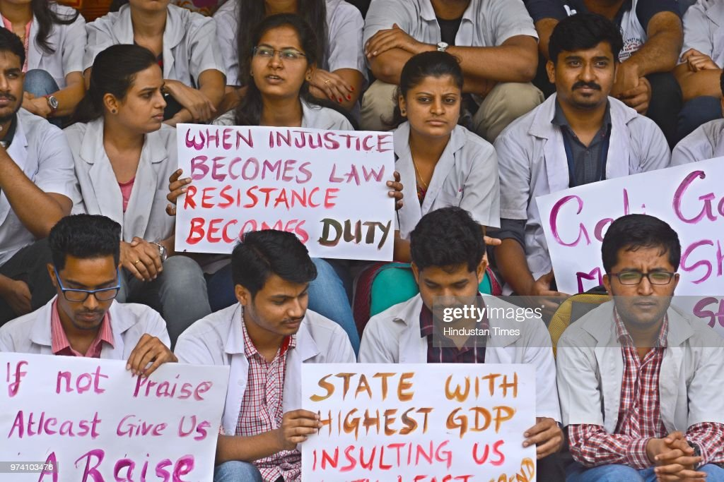 Students of BJ Medical College stage a protest demanding hike on their stipend, on June 13, 2018 in Pune, India.