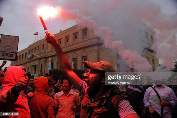 Students of Cairo University chant slogans during an anticoup protest in Cairo Egypt on November 2 2014