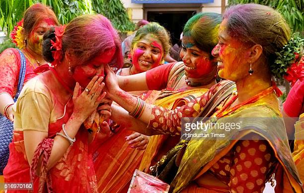 Students of Calcutta University celebrating Holi festival at University Campus on March 22 2016 in Kolkata India Holi or festival of colours is...