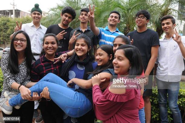 Students of Delhi Public School celebrate their success after Central Board of Secondary Educations declared class 10th results on May 29 2018 in...