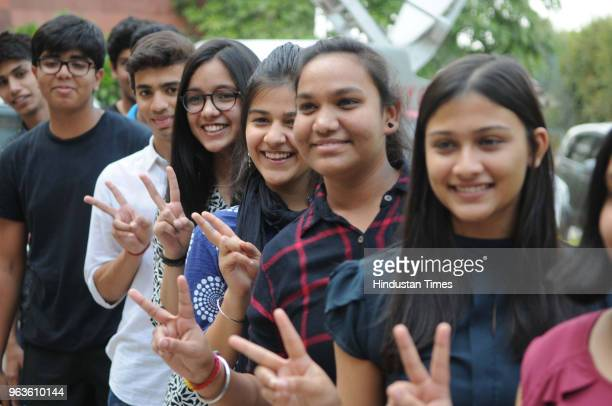 Students of Delhi Public School show victory sign as they celebrate their success after Central Board of Secondary Educations declared class 10th...