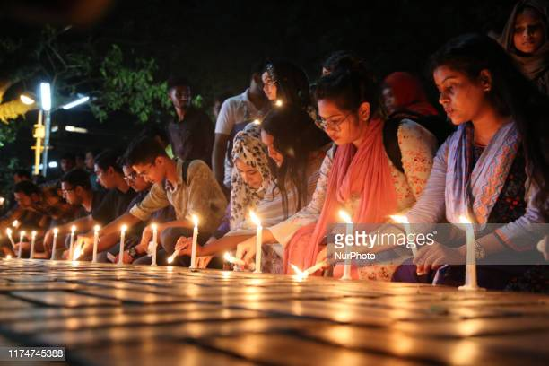 Students of Dhaka University attend their torchlights march to ask for justice for protesters after a pupil was allegedly beaten to death by ruling...