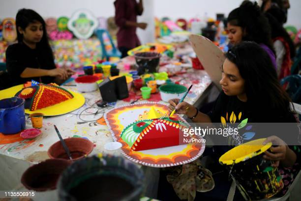 Students of Dhaka University Fine Arts Faculty paint on traditional masks to sell ahead of Bengali New Year Celebration in Dhaka Bangladesh on April...