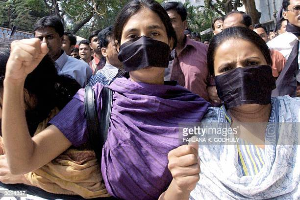Students of Dhaka university march on their campus during a demonstration by students teachers and political leaders staged to protest an attack on...