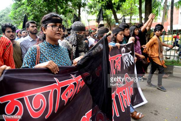 Students of Dhaka University take part in a protest with back flag in Dhaka Bangladesh on October 9 after a pupil was allegedly beaten to death by...