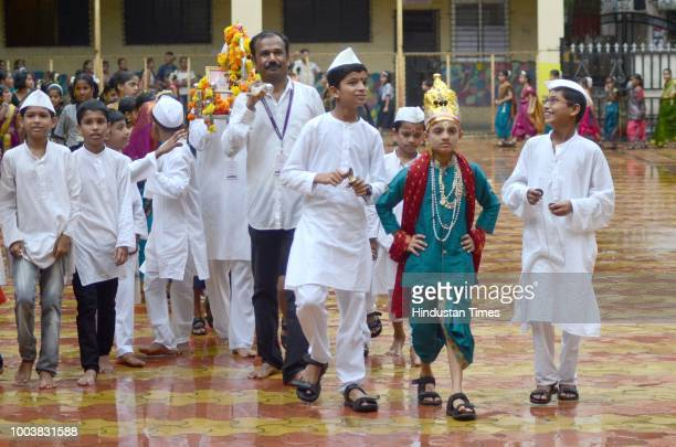 Students of Dyan Vikas School Kopar Khairane celebrate Dindi procession ahead of Ashadi Ekadhsi festival celebrated across Maharashtra on Monday on...