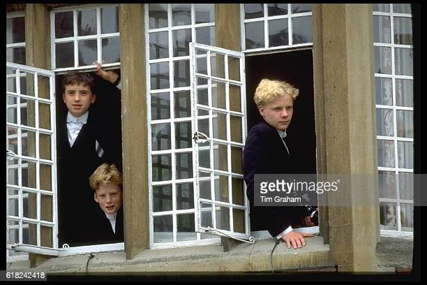 Students of Eton College elite Boarding School at windows during celebration of 500th Anniversary Wealth Riches Higher Education Tradition Posh