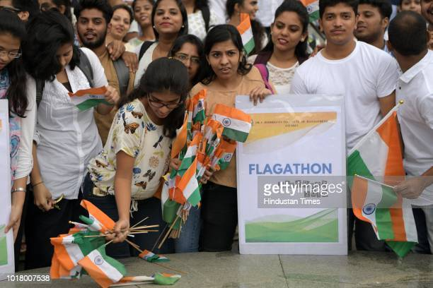 Students of Fr C Rodrigues Institute of Management Studies collect flags which are thrown on the streets and submit it to NMMC at Vashi on August 16...