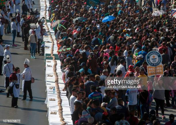 Students of gastronomy break the Guinness World Record with a 206343metre king cake the longest in the world in Saltillo Coahuila State Mexico on...