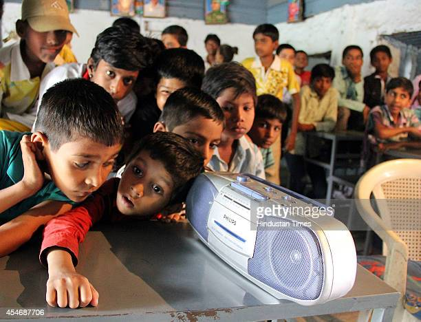 Students of Government Urdu School listening on the radio a broadcast by Indian Prime Minister Narendra Modi delivering his Teachers' Day speech on...