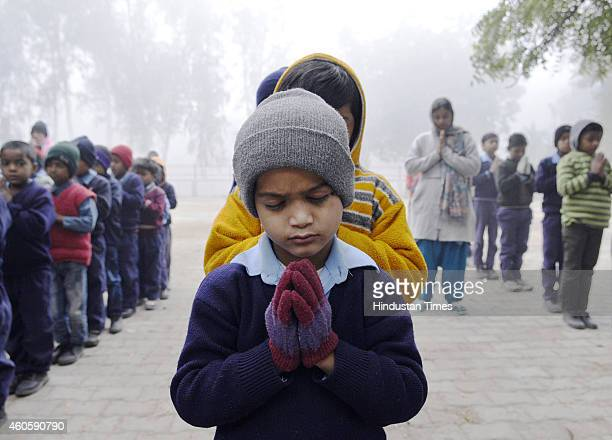 Students of Govt Primary School Village Pochanpur paying tribute to the victims of Peshawar school attack on December 17 2014 in New Delhi India 141...