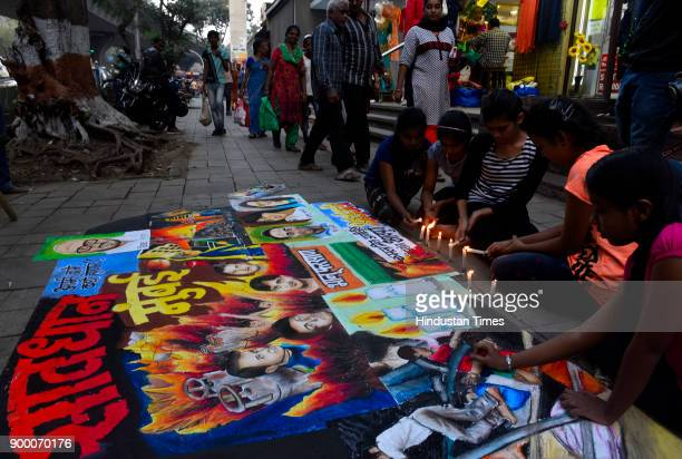 Students of Gurukul Art of school Lalbaug painted a drawing and paid tribute people who died in fire at Kamla Mill compound on December 30 2017 in...