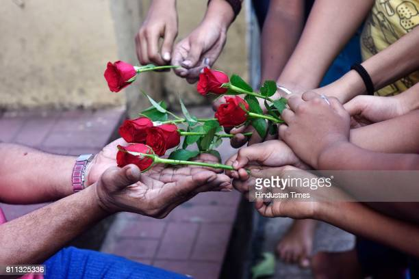 Students of Gurukul School of Art give roses to their teachers on the eve of Guru Purnima at Parel on July 8 2017 in Mumbai India Guru Purnima is the...