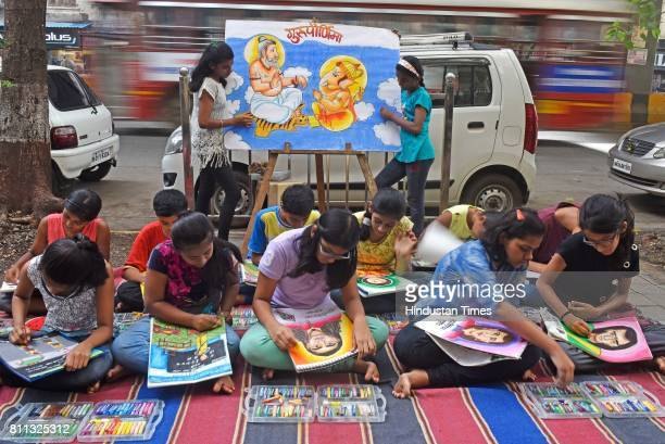 Students of Gurukul School of Art painting of their favourite teachers on the eve of Guru Purnima at Parel on July 8 2017 in Mumbai India Guru...