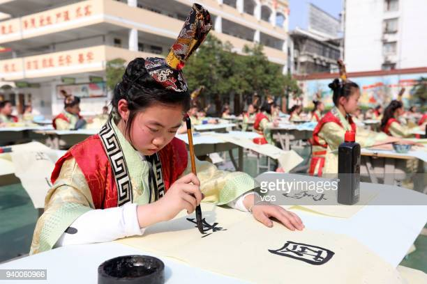 Students of Huaibei City Gucheng Road Primary School attend a calligraphy competition on March 30, 2018 in Huaibei, Anhui Province of China.