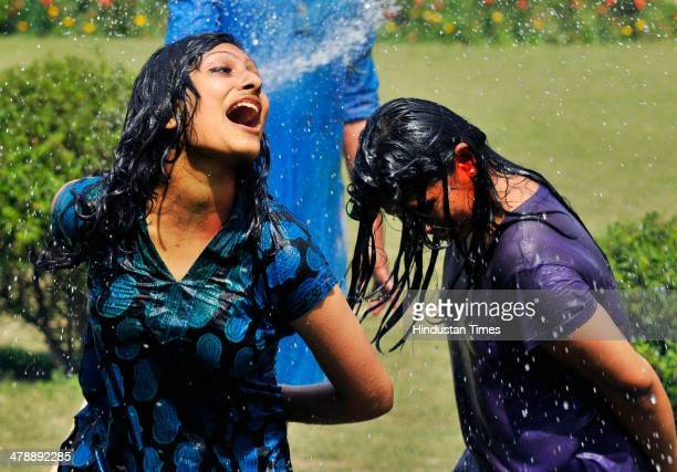 Students of Institute of Management Studies playing holi with each other before the Holi festival on March 15 2014 in Noida India Holi is a festival...