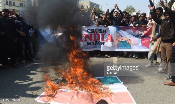 Students of Islami Jamiat Talaba a wing of religious political party Pakistan JamaateIslami burn an Indian flag and chant slogans during an antiIndia...