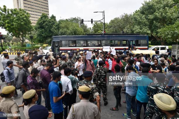 Students of Jawaharlal Nehru University protest against the government for not helping the people in Kerala affected from floods at Parliament Street...