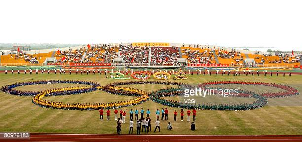 Students of Jiangxi Normal University celebrate the 100 day Olympic countdown. Chinese authorities are organizing various events including a...