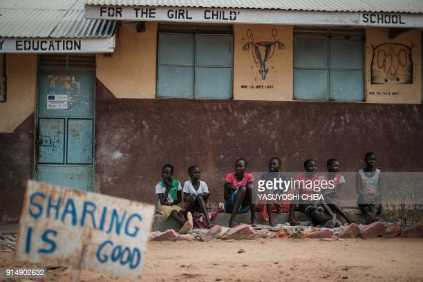 TOPSHOT Students of Kalas Girl's primary school which hosts escaped girls from female genital mutilation and child marriage sit near a messagee place...