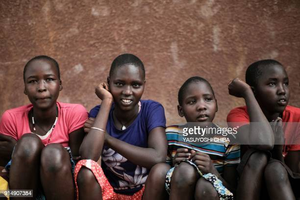 Students of Kalas Girl's primary school which hosts escaped girls from female genital mutilation and child marriage pose in Amudat town northeast...