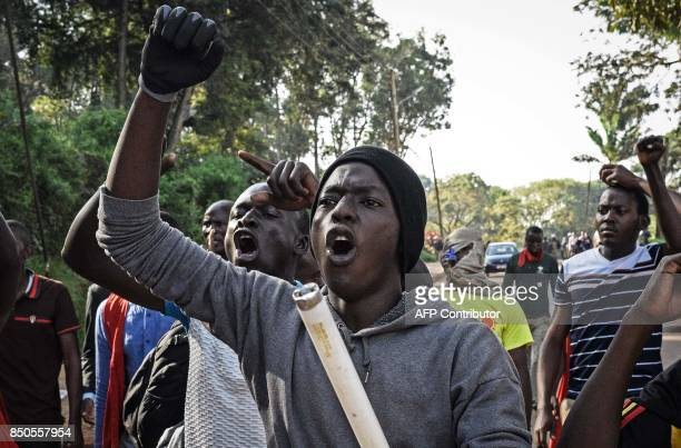 Students of Makerere University protest against the official procedure to scrap a presidential age limit from the constitution in Kampala on...