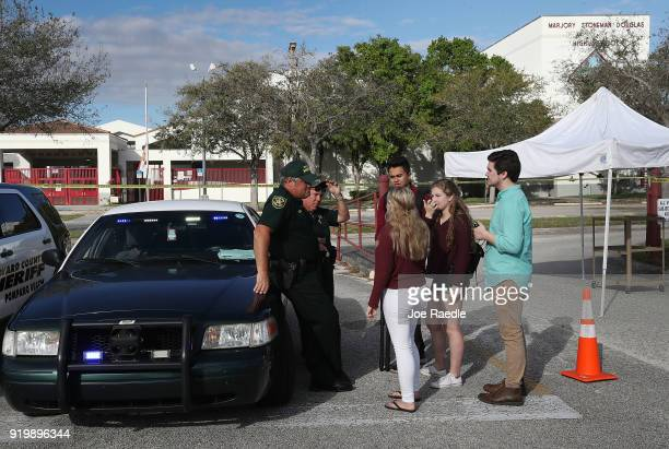 Students of Marjory Stoneman Douglas High School speak with Broward County Sheriff officers Brad Griesinger and Jamie Rubenstein who are guarding the...