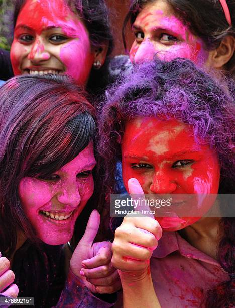 Students of Max Muller Bhawan playing holi with each other before the Holi festival on March 15 2014 in New Delhi India Holi is a festival of colors...