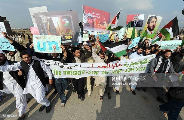 Students of Pakistani International Islamic University carry placards as they shout slogans during an antiIsrael protest rally in Islamabad on...